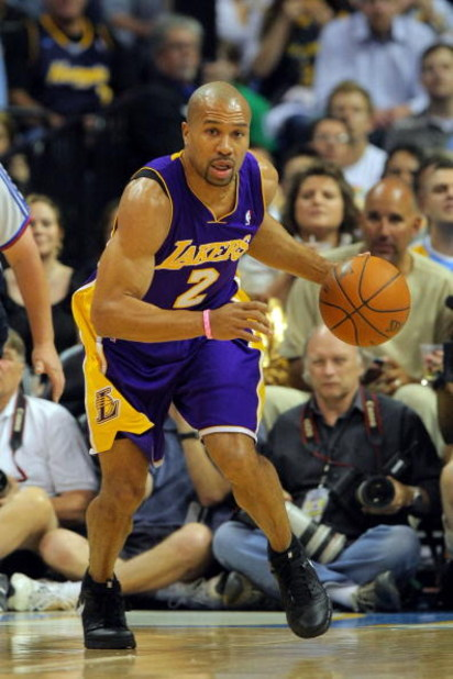 DENVER - MAY 29:  Derek Fisher #2 of the Los Angeles Lakers moves the ball against the Denver Nuggets in Game Six of the Western Conference Finals during the 2009 NBA Playoffs at Pepsi Center on May 29, 2009 in Denver, Colorado. NOTE TO USER: User express