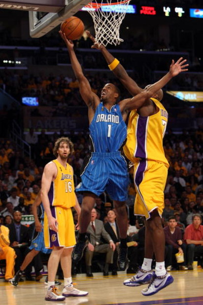 LOS ANGELES, CA - JUNE 04:  Rafer Alston #1 of the Orlando Magic lays the ball up over Lamar Odom #7 and Pau Gasol #16 of the Los Angeles Lakers in Game One of the 2009 NBA Finals at Staples Center on June 4, 2009 in Los Angeles, California. NOTE TO USER: