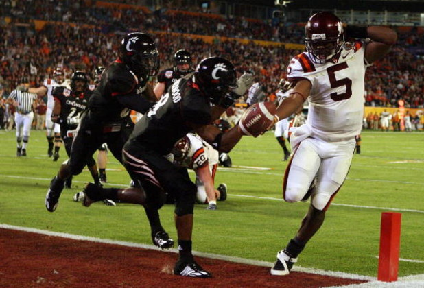 MIAMI - JANUARY 01:  Tyrod Taylor #5 of the Virginia Tech Hokies runs the ball for a toucdown against Brandon Underwood #8 of the Cincinnati Bearcats during the FedEx Orange Bowl against at Dolphin Stadium on January 1, 2009 in Miami, Florida.  (Photo by