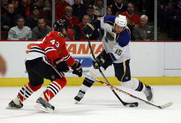 CHICAGO - JANUARY 21: Brad Winchester #15 of the St. Louis Blues fires a shot against James Wisniewski #43 of the Chicago Blackhawks on January 21, 2009 at the United Center in Chicago, Illinois. (Photo byJonathan Daniel/Getty Images)