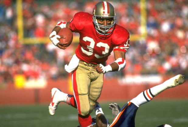 24 DEC 1989:  SAN FRANCISCO 49ERS RUNNING BACK ROGER CRAIG CARRIES THE FOOTBALL DURING THE 49ERS 26-0 WIN OVER THE CHICAGO BEARS AT CANDLESTICK PARK IN SAN FRANCISCO, CALIFORNIA.