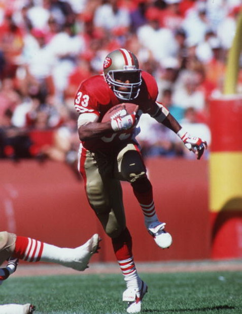 16 SEP 1990:  SAN FRANCISCO RUNNING BACK ROGER CRAIG CARRIES THE FOOTBALL IN THE OPEN FIELD DURING THE 49ERS 26-13 VICTORY OVER THE WASHINGTON REDSKINS AT CANDLESTICK PARK IN SAN FRANCISCO, CALIFORNIA. Mandatory Credit: Otto Greule/ALLSPORT