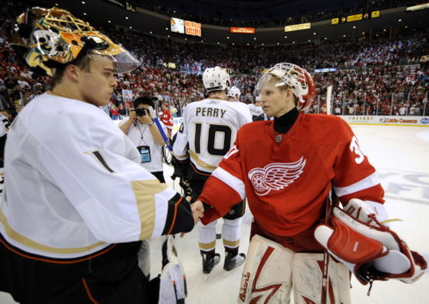 DETROIT - MAY 14: Jonas Hiller #1 of the Anaheim Ducks shakes hands with Chris Osood #30 of the Detroit Red Wings after losing 4-3 in Game Seven of the Western Conference Semifinals of the 2009 NHL Stanley Cup Playoffs on May 14, 2009 at Joe Louis Arena i