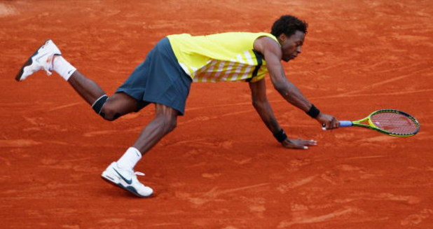PARIS - JUNE 01:  Gael Monfils of France falls whilst trying to reach the ball during the Men's Fourth Round match against Andy Roddick of USA on day nine of the French Open at Roland Garros on June 1, 2009 in Paris, France.  (Photo by Clive Brunskill/Get
