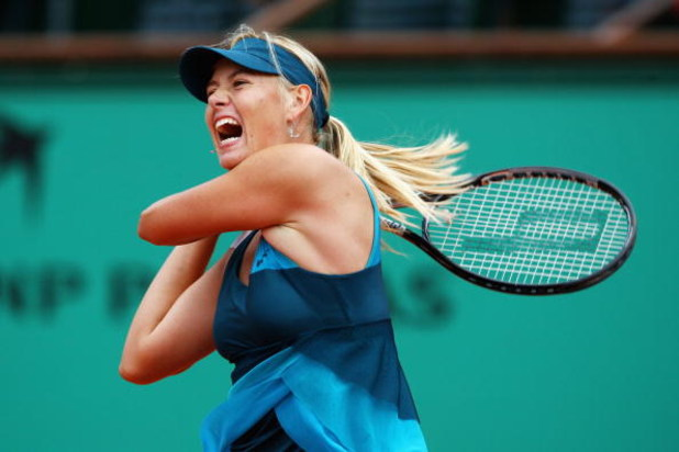 PARIS - MAY 31:  Maria Sharapova of Russia hits a forehand during the Women's Singles Fourth Round match against Na Li of China on day eight of the French Open at Roland Garros on May 31, 2009 in Paris, France.  (Photo by Clive Brunskill/Getty Images)