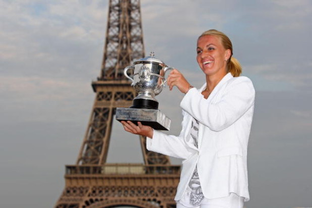 PARIS - JUNE 06:  New ladies French Open champion Svetlana Kuznetsova of Russia poses with the trophy in front of the Eiffel Tower on day fourteen of the French Open on June 6, 2009 in Paris, France.  (Photo by Ryan Pierse/Getty Images)
