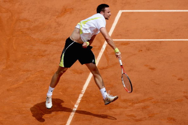 PARIS - JUNE 07:  Robin Soderling of Sweden servesduring the Men's Singles Final match against Roger Federer of Switzerland on day fifteen of the French Open at Roland Garros on June 7, 2009 in Paris, France.  (Photo by Matthew Stockman/Getty Images)