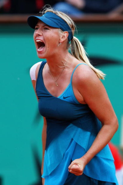 PARIS - MAY 31:  Maria Sharapova of Russia celebrates a point during the Women's Singles Fourth Round match against Na Li of China on day eight of the French Open at Roland Garros on May 31, 2009 in Paris, France.  (Photo by Clive Brunskill/Getty Images)