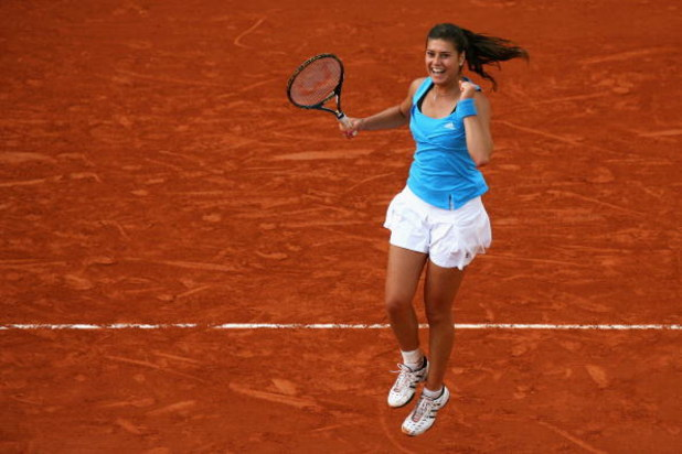 PARIS - JUNE 01:  Sorana Cirstea of Romania celebrates victory during the Women's Singles Fourth Round match against Jelena Jankovic of Serbia on day nine of the French Open at Roland Garros on June 1, 2009 in Paris, France.  (Photo by Matthew Stockman/Ge