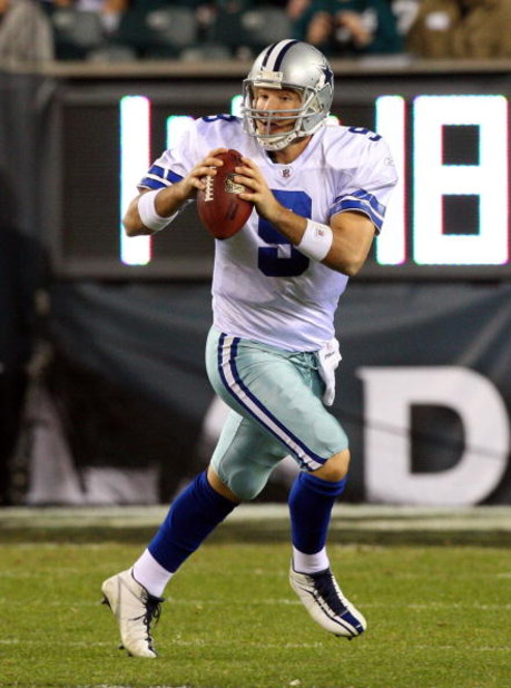 PHILADELPHIA - DECEMBER 28:  Tony Romo #9 of the Dallas Cowboys scrambles against the Philadelphia Eagles on December 28, 2008 at Lincoln Financial Field in Philadelphia, Pennsylvania.  (Photo by Jim McIsaac/Getty Images)