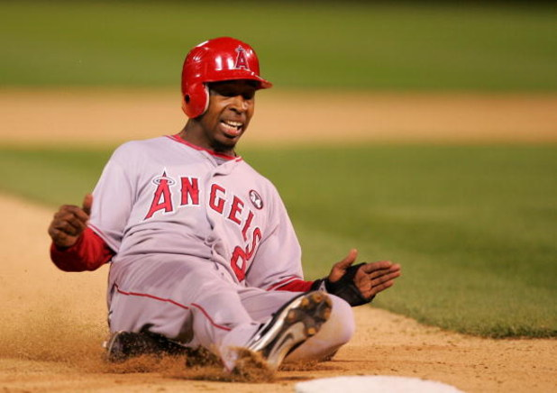 OAKLAND, CA - MAY 04:  Chone Figgins #9 of the Los Angeles Angels of Anaheim slides in to third base during their game against the Oakland Athletics on May 4, 2009 at the Oakland Coliseum in Oakland, California.  (Photo by Ezra Shaw/Getty Images)