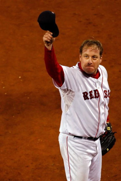 BOSTON - OCTOBER 20:  Starting pitcher Curt Schilling #38 of the Boston Red Sox tips his hat to the crowd after closing out the seventh inning against the Cleveland Indians during Game Six of the American League Championship Series at Fenway Park on Octob