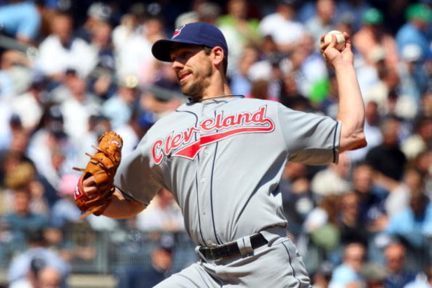 NEW YORK - APRIL 16:  Cliff Lee #31 of the Cleveland Indians pitches against the New York Yankees during opening day at the new Yankee Stadium on April 16, 2009 in the Bronx borough of New York City. This is the first regular season MLB game being played