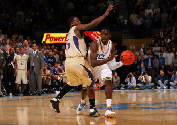 WESTWOOD, CA - FEBRUARY 19:  Jrue Holiday #21 of the UCLA Bruins looks to make a pass play around Justin Dentmon #5 of the Washington Huskies in the second half during their NCAA basketball game at Pauley Pavilion on February 19, 2009 in Westwood, Califor
