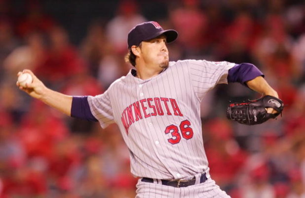 ANAHEIM, CA - AUGUST 21:  Joe Nathan #36 of the Minnesota Twins pitches in the 12th inning against the Los Angeles Angels of Anaheim at Angels Stadium on August 21, 2008 in Anaheim, California.  (Photo by Lisa Blumenfeld/Getty Images)