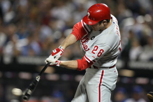 NEW YORK - JUNE 10:  Chase Utley #26 of the Philadelphia Phillies bats against  the New York Mets during their game on June 10, 2009 at Citi Field in the Flushing neighborhood of the Queens borough of New York City.  (Photo by Al Bello/Getty Images)