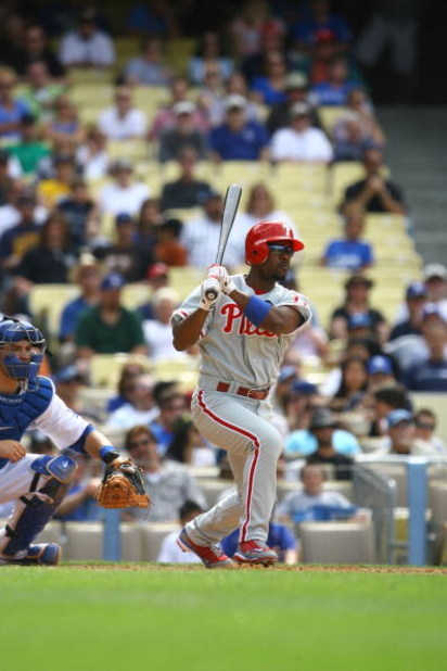 LOS ANGELES, CA - JUNE 06:  Jimmy Rollins #11 of the Philadelphia Phillies swings at a pitch and runs to first base during the game against the Los Angeles Dodgers at Dodger Stadium on June 6, 2009 in Los Angeles, California. The Dodgers defeated the Phil