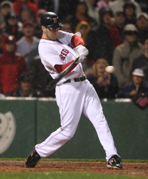 BOSTON - JUNE 11: Jason Bay #44 of the Boston Red Sox hits a single to knock in a run to tie the New York Yankees at Fenway Park on June 11, 2009 in Boston, Massachusetts.  (Photo by Jim Rogash/Getty Images)