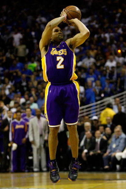 ORLANDO, FL - JUNE 11:  Derek Fisher #2 of the Los Angeles Lakers shoots during the game against the Orlando Magic in Game Four of the 2009 NBA Finals on June 11, 2009 at Amway Arena in Orlando, Florida.  NOTE TO USER:  User expressly acknowledges and agr