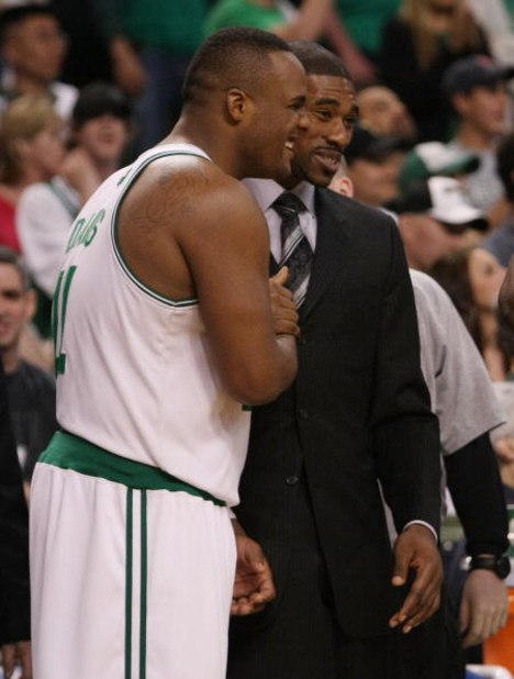 BOSTON - MAY 02:  Glen Davis #11 and Leon Powe #0 of the Boston Celtics celebrate the win over the Chicago Bulls in Game Seven of the Eastern Conference Quarterfinals during the 2009 NBA Playoffs at TD Banknorth Garden on May 2, 2009 in Boston, Massachuse