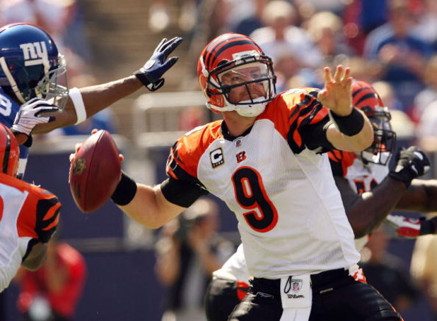 EAST RUTHERFORD, NJ - SEPTEMBER 21:  Carson Palmer #9 of the Cincinnati Bengals looks to pass as he is pressured by the New York Giants defense on September 21, 2008 at Giants Stadium in East Rutherford, New Jersey  (Photo by Elsa/Getty Images)