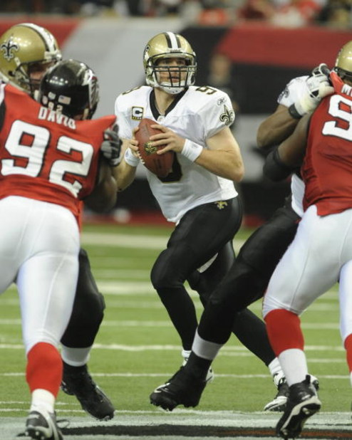 ATLANTA - NOVEMBER 9: Quarterback Drew Brees #9 of the New Orleans Saints sets to pass against the Atlanta Falcons at the Georgia Dome on November 9, 2008 in Atlanta, Georgia.  (Photo by Al Messerschmidt/Getty Images)