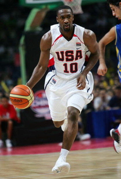 GUANGZHOU, CHINA - AUGUST 8:  Gilbert Arenas of the USA Senior Men's National Team controls the ball against Brazil Men's National Team during the China Basketball Challenge August 8, 2006 in Guangzhou, Guangdong province, China. USA won the game, 90-86.
