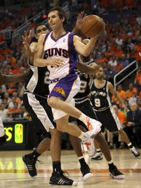 PHOENIX - APRIL 25:  Steve Nash #13 of the Phoenix Suns is defended by Tim Duncan #21 of the San Antonio Spurs during Game Three of the Western Conference Quarterfinals during the 2008 at NBA Playoffs at the at U.S. Airways Center on April 25, 2008.  (Pho