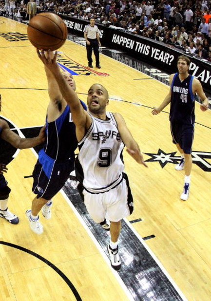 SAN ANTONIO - APRIL 28:  Guard Tony Parker #9 of the San Antonio Spurs takes a shot against Jason Kidd #2 of the Dallas Mavericks in Game Five of the Western Conference Quarterfinals during the 2009 NBA Playoffs at AT&T Center on April 28, 2009 in San Ant