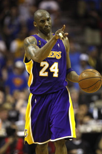 ORLANDO, FL - JUNE 11:  Kobe Bryant #24 of the Los Angeles Lakers moves the ball against the Orlando Magic in Game Four of the 2009 NBA Finals on June 11, 2009 at Amway Arena in Orlando, Florida. The Lakers won in overtime 99-91. NOTE TO USER:  User expre