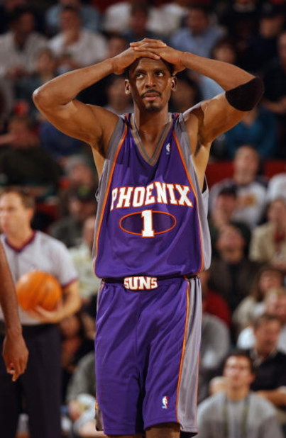 SEATTLE - OCTOBER 30:  Anfernee Hardaway #1 of the Phoenix Suns reacts during the game against the Seattle Sonics at Key Arena on October 30, 2002 in Seattle, Washington.  The Sonics won 86-73.  NOTE TO USER: User expressly acknowledges and agrees that, b
