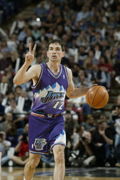 SACRAMENTO, CA - APRIL 30:  John Stockton #12 of the Utah Jazz dribbles in Game five of the Western Conference Quarterfinals against the Sacramento Kings during the 2003 NBA Playoffs at Arco Arena on April 30, 2003 in Sacramento, California.  The Kings wo
