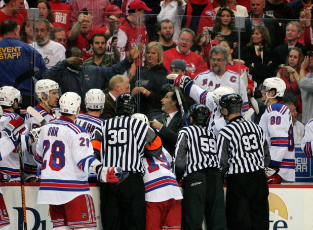 WASHINGTON - APRIL 24:   Head Coach John Tortorella of the New York Rangers battles with some of the fans of the Washington Capitals during Game Five of the Eastern Conference Quarterfinal Round of the 2009 Stanley Cup Playoffs on April 24, 2009 at the Ve