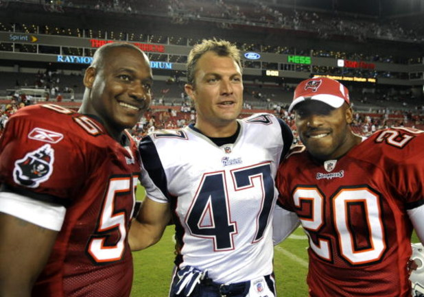 TAMPA, FL - AUGUST 17: Defensive back John Lynch #47 of the New England Patriots greets former Tampa Bay Buccaneers teammates Derrick Brooks #55 and Ronde Barber #20 after play at Raymond James Stadium on August 17, 2008 in Tampa, Florida.   (Photo by Al
