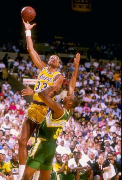 1988-1989 season:  Center Kareem Abdul-Jabbar of the Los Angeles Lakers moves the ball during a game. Mandatory Credit: Tim de Frisco  /Allsport
