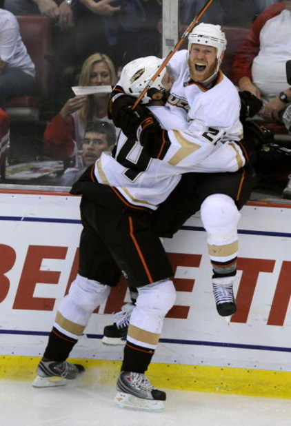 DETROIT - MAY 03: Todd Marchant #22 of the Anaheim Ducks celebrates his game winning goal in the third overtime with Rob Niedermayer #44 to beat the Detroit Red Wings 4-3 in Game Two of the Western Conference Semifinals of the 2009 NHL Stanley Cup Playoff