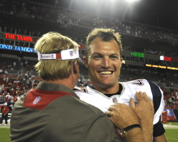TAMPA, FL - AUGUST 17: Defensive back John Lynch #47 of the New England Patriots greets coach Jon Gruden of the Tampa Bay Buccaneers after play at Raymond James Stadium on August 17, 2008 in Tampa, Florida.   (Photo by Al Messerschmidt/Getty Images)