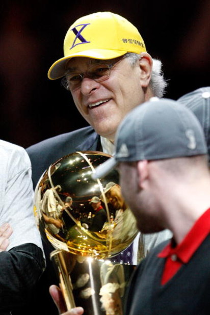 ORLANDO, FL - JUNE 14:  Head coach Phil Jackson of the Los Angeles Lakers holds up the Larry O'Brien trophy after the Lakers defeated the Orlando Magic 99-86 in Game Five of the 2009 NBA Finals on June 14, 2009 at Amway Arena in Orlando, Florida.  NOTE TO