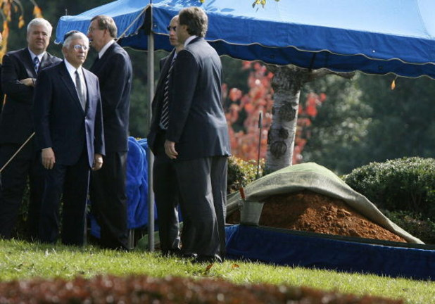 FALLS CHURCH, VA - OCTOBER 31:  NBA Commissioner David Stern (2nd L) stands with mourners near the tent covering Red Auerbach's grave after his funeral at King David Memorial Cemetery October 31, 2006 in Falls Church, Virginia. Auerbach, who led the Bosto