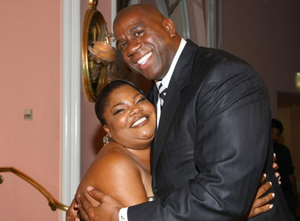 LOS ANGELES, CA - MAY 06:  Former NBA player Earvin 'Magic' Johnson (R) hugs comedian Mo'Nique during the USA TODAY Hollywood Hero honoring Magic Johnson at the Beverly Hills Hotel on May 6, 2008 in Los Angeles, California.  (Photo by Alberto E. Rodriguez