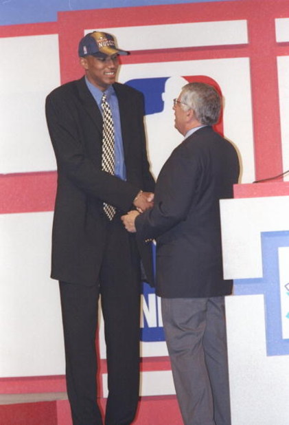 25 Jun 1997:  Forward Tony Battie of the Denver Nuggets shakes hands with NBA Commissioner David Stern during the NBA Draft at the Charlotte Coliseum in Charlotte, North Carolina. Mandatory Credit: Craig Jones  /Allsport