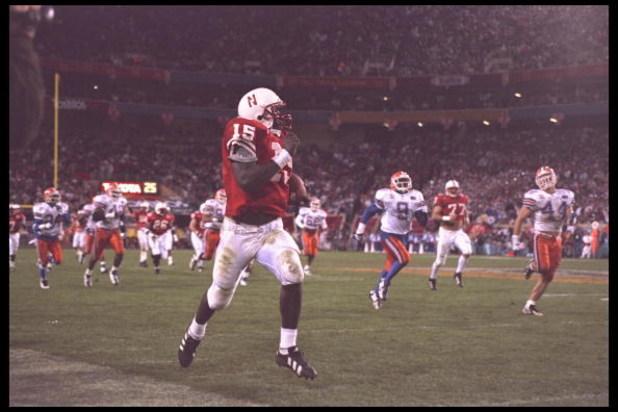 2 Jan 1996:  Quarterback Tommie Frazier #15 of the Florida Gators takes his quarterback keeper to the endzone for a score against the Nebraska Cornhuskers in the Fiesta Bowl at Sun Devil Stadium in Tempe, Arizona.  Nebraska defeated Florida 62-24.    Mand