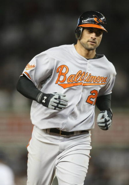 NEW YORK - MAY 21:  Nick Markakis #21 of the Baltimore Orioles runs the bases against the New York Yankees on May 21, 2009 at Yankee Stadium in the Bronx borough of New York City.  (Photo by Nick Laham/Getty Images)