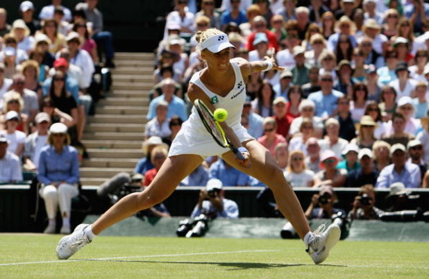 LONDON - JULY 03:  Elena Dementieva of Russia plays a forehand during the women's singles Semi Final match against Venus Williams of United States on day ten of the Wimbledon Lawn Tennis Championships at the All England Lawn Tennis and Croquet Club on Jul