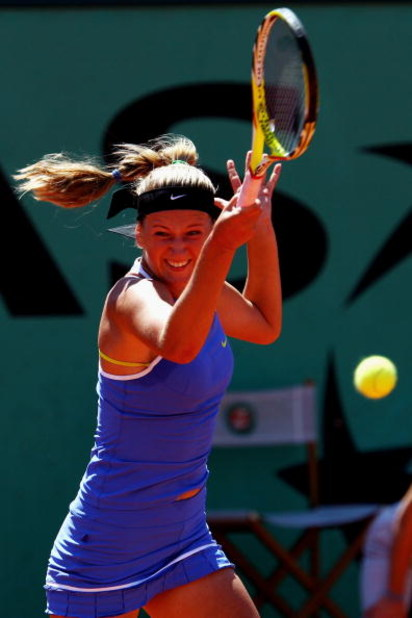 PARIS - MAY 30:  Victoria Azarenka of Belarus hits a forehand during her Women's Singles Third Round match against Carla Suarez Navarro of Spain on day seven of the French Open at Roland Garros on May 30, 2009 in Paris, France.  (Photo by Clive Brunskill/