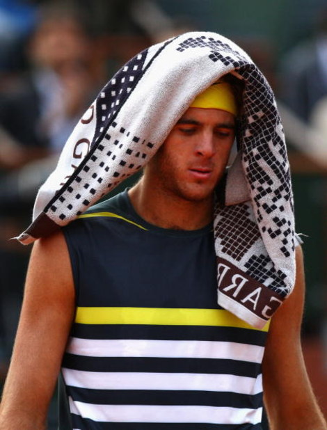 PARIS - JUNE 05:  A dejected Juan Martin Del Potro of Argentina reacts during the Men's Singles Semi Final match against Roger Federer of Switzerland on day thirteen of the French Open at Roland Garros on June 5, 2009 in Paris, France.  (Photo by Ryan Pie