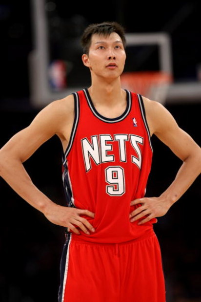LOS ANGELES, CA - NOVEMBER 25:  Yi Jianlian #9 of the New Jersey Nets rests during a break in the game against the Los Angeles Lakers on November 25, 2008 at Staples Center in Los Angeles, California. The Lakers won 120-93.   NOTE TO USER: User expressly