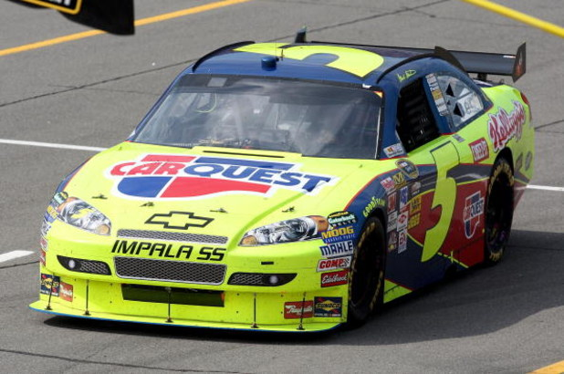 BROOKLYN, MI - JUNE 14: Mark Martin, driver of the #5 CARQUEST/Kellogg's Chevrolet, drives down pit row after winning the NASCAR Sprint Cup Series LifeLock 400 at Michigan International Speedway on June 14, 2009 in Brooklyn, Michigan. (Photo by Jonathan D