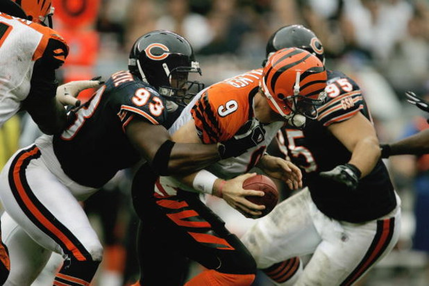 CHICAGO - SEPTEMBER 25:  Adewale Ogunleye #93 of the Chicago Bears sacks Carson Palmer #9 of the Cincinnati Bengals on September 25, 2005 at Soldier Field in Chicago, Illinois. The Bengals defeated the Bears 24-7. (Photo by Jonathan Daniel/Getty Images)