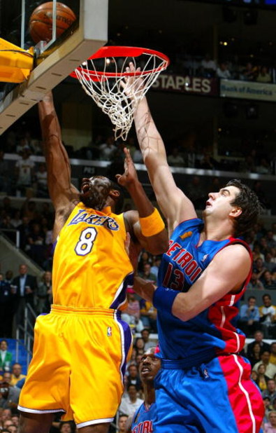 LOS ANGELES - JUNE 8:  Mehmet Okur #13 of the Detroit Pistons attempts to block Kobe Bryant #8 of the Los Angeles Lakers in the first half of Game 2 of the 2004 NBA Finals on June 8, 2004 at Staples Center in Los Angeles, California.  NOTE TO USER: User e